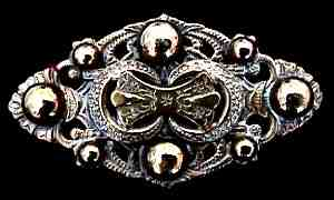 Brass Brooch, c. 1890, $28 Retail