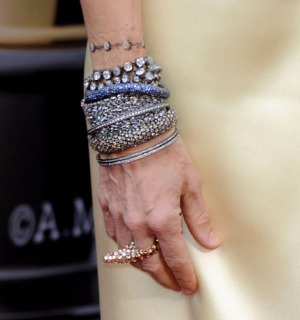 A luxurious tangle of bracelets worn by Sarah Jessica Parker to the 2010 Academy Awards. A pretty penny from Fred Leighton and Cartier, no?